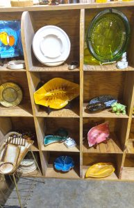 A collection of colorful retro ashtrays.